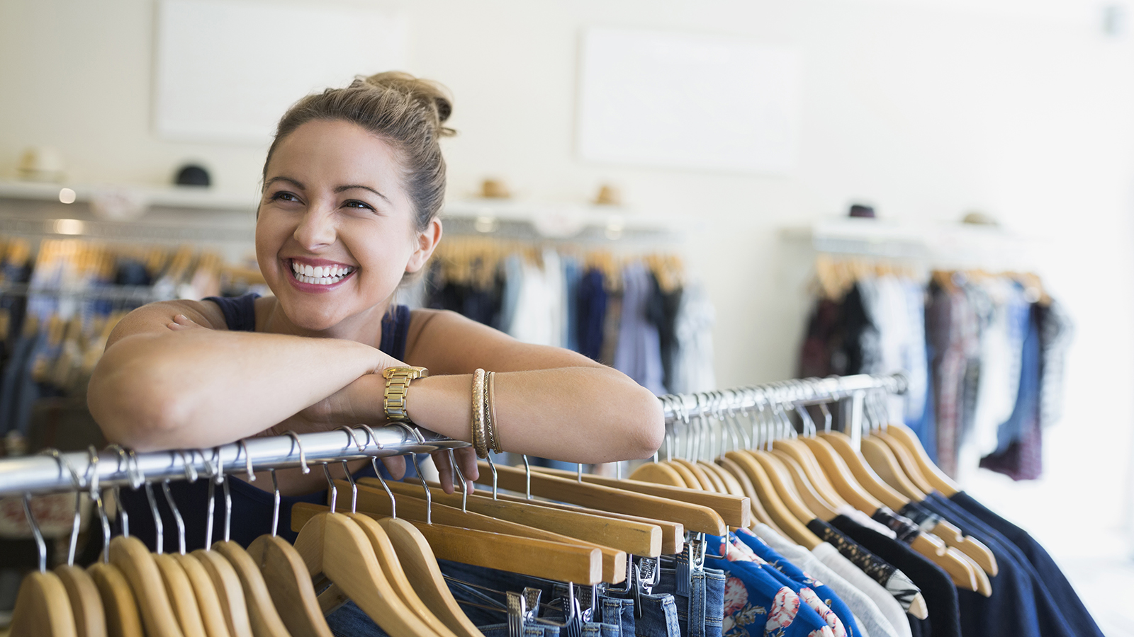 A woman traveler smiling in an apparel shop.
